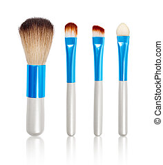 Makeup Brushes with reflection on isolated white background