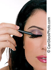 Makeup closeup - Woman applying makeup - closeup