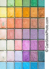 Makeup colorful eyeshadow palettes as background
