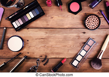 makeup cosmetics on wooden background. top view with copy space