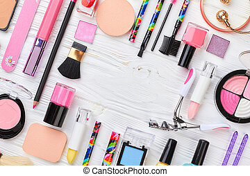 Makeup cosmetics set on wooden background.