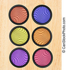 makeup eyeshadow on wooden background
