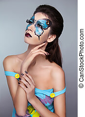 Makeup. Face art portrait. Manicured nails. Fashion female model posing isolated on gray background.