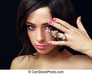 Makeup female model with fashion ring on hand. Closeup portrait