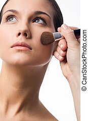 Makeup - Fresh girl having makeup procedure over white...