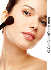 Makeup - Fresh girl with touch of powder brush over white...