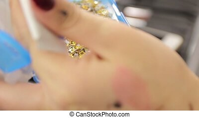Makeup Gold Sparkles - Makeup gold sparkles stars in hand...