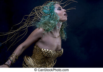 Makeup Latin woman with green hair and gold costume with handmade flourishes, fantasy image and tale