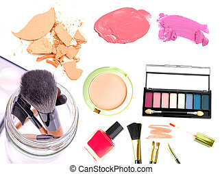 Makeup. Make-up Set. Collage, lipgloss, lipstick, rouge, eyeshadows, eyeliner, foundation isolated on a white background