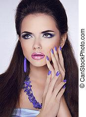 Makeup. Manicured nails. Beauty Fashion Brunette Woman Portrait. Trendy Fashion Jewelry.