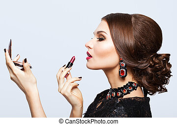 Makeup of young beautiful brunette woman in black dress with...
