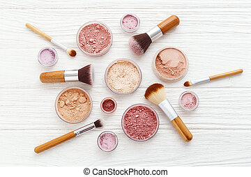 Makeup powder products with brushes flat lay - Makeup powder...