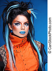 Makeup. Rock hairstyle. Portrait of young beautiful punk ...