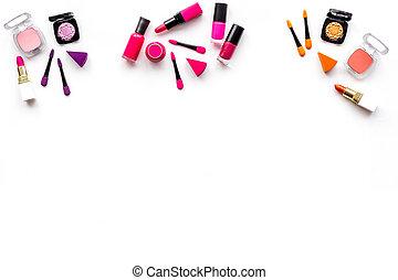 Makeup set. Eyeshadows, rouge, lipstick, applicators on white background top view copyspace