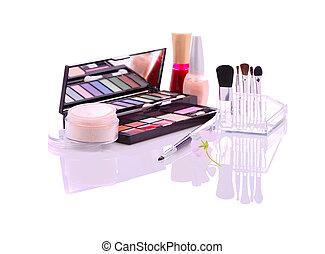 makeup set with eyeshadows, lip gloss, powder, brushes, nail polish