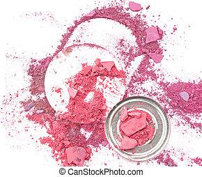 makeup sponge and broken multicolor eyeshadow
