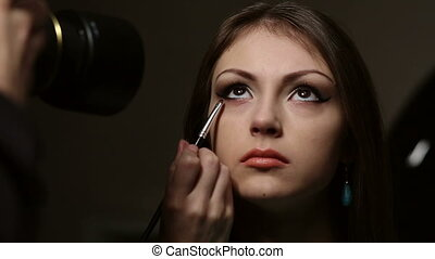 Makeup - Photosession of a model while applying makeup