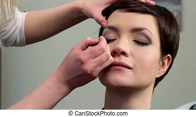 Makeup - Stylist doing makeup for young woman