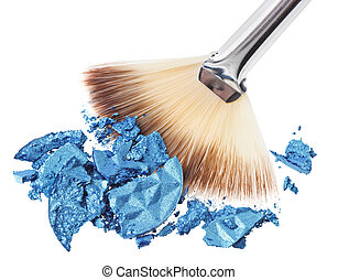 Makeup wide brush with blue crushed eye shadow, isolated on white macro