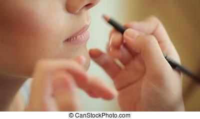 Makeup with lip pencil closeup
