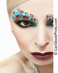 Makeup with turquoise stones.