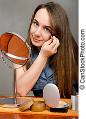 makeup woman sitting at the table