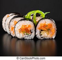 Maki sushi over black