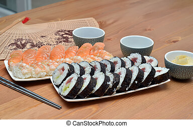 maki sushi rolls and nigiri sushi on plate japan food on the...