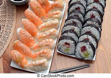 maki sushi rolls and nigiri sushi with salmon and shrimp...