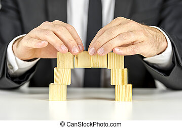 Making a bridge with wooden cubes