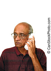 Old Indian Immigrant making a telephone call