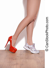 Making a choice. Close-up of woman wearing heeled shoe and...
