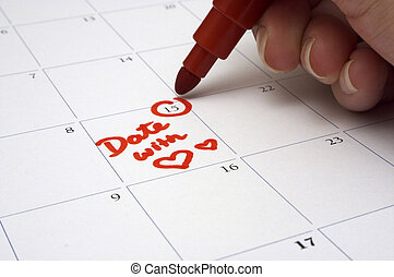 Making A Date - A person writing down the appointment for a...