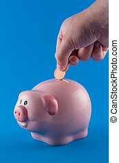 Making a Deposit - Putting a coin into a money box
