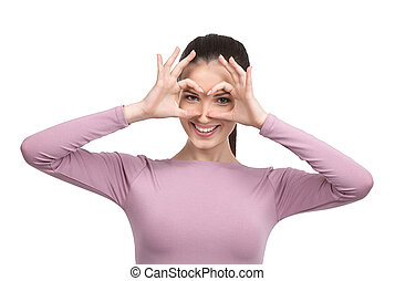 Making a face. Cheerful young woman making a face and gesturing while standing isolated on white
