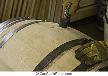 Making a hole in a wine barrel