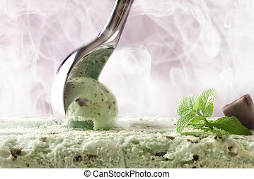 Making a mint choco ice cream with scoop front view