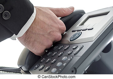 Making a phone call - Closeup of a male receptionist making...