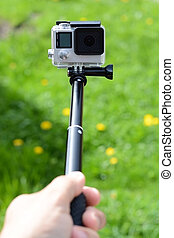 Making a selfie with a camera and stick