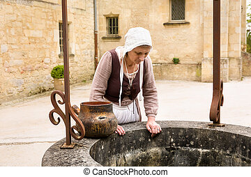 Making a wish at medieval water well