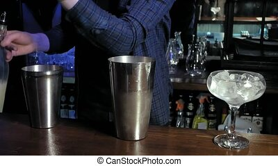 making an alcoholic cocktail at the bar