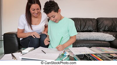 Making Art with Mum at Home - Little boy and his mother are...