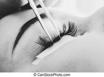 Making artificial lashes. eyelash extension procedure