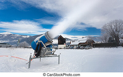 artificial snow on ski resort at cold day in Alps - Making...