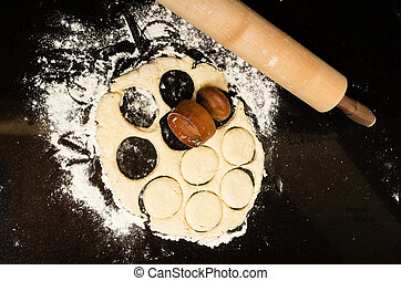 Making biscuits with rolling pin and dough