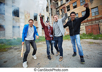Making blast - Portrait of dangerous guys exploding burning...