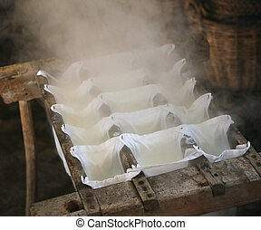 making cheese in a cheese factory in the mountain hut
