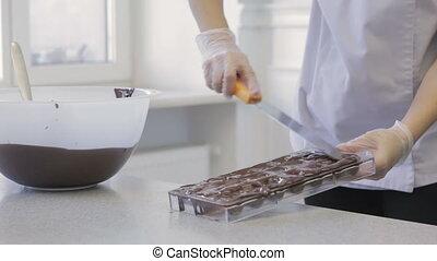 Making chocolates candies