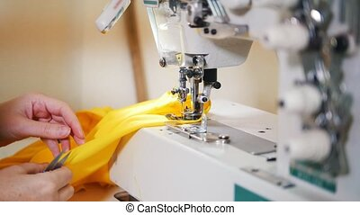 Making clothes. Woman works on Sewing Machine. 4K shot....