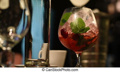 Making cocktail in bar - Closeup photo in a bar where barmen...